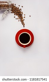 Creative concept photo of coffee cup and bottle with beans on grey background.