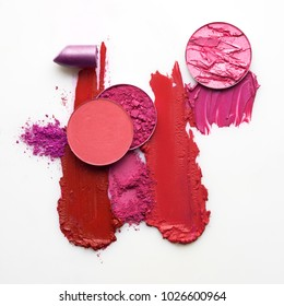 Creative concept photo of cosmetics swatches beauty products lipstick round eyeshadow on white background.
