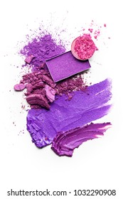 Creative concept photo of cosmetics swatches beauty products lipstick round and square eyeshadow on white background.