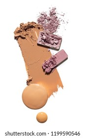 Creative concept photo of cosmetics swatches beauty products foundation cream square eyeshadow on white background.