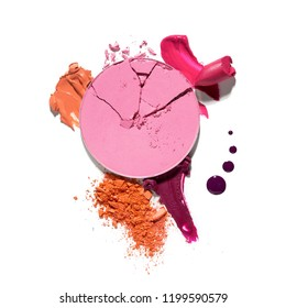 Creative concept photo of cosmetics swatches beauty products lipstick lip gloss round eyeshadow on white background.