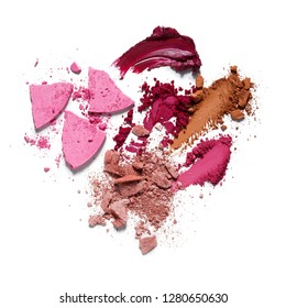 Creative concept photo of cosmetics swatches beauty products lipstick eyeshadow on white background.