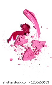Creative concept photo of cosmetics swatches beauty products lipstick lip gloss eyeshadow on white background.
