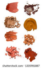 Creative concept photo of cosmetics swatches beauty products lipstick eyeshadow foundation cream on white background.