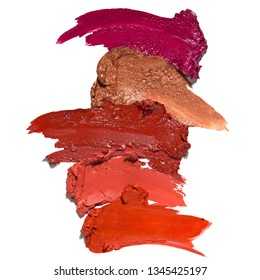 Creative concept photo of cosmetics swatches beauty products lipstick white background.