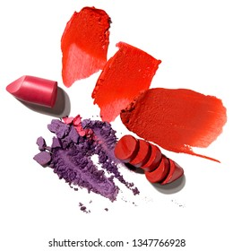 Creative concept photo of cosmetics swatches beauty products lipstick and eyeshadow on white background.