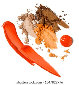 Creative concept photo of cosmetics swatches beauty products lip gloss and eyeshadow on white background.