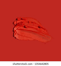 Creative concept photo of cosmetics swatches on red background.
