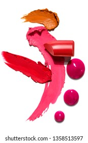 Creative concept photo of cosmetics swatches beauty products lipstick lip gloss on white background.