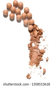 Creative concept photo of cosmetics swatches beauty products blusher balls pearls on white background.
