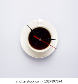 Creative concept photo of cup of coffee with clock hands on grey background.