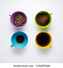 Creative concept photo of cups with beans and instant coffee on grey background.