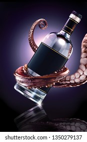 Creative concept photo of octopus tentacle holding the bottle with drink beverage alcohol spirits on mirror surface.