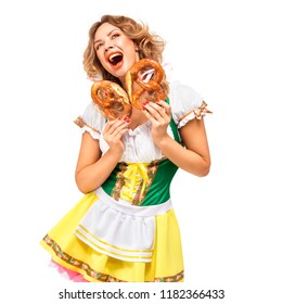 Creative concept photo of Oktoberfest waitress wearing a traditional Bavarian costume with pretzels isolated on white background.