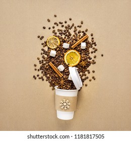 Creative concept photo of take away coffee cup on brown background.