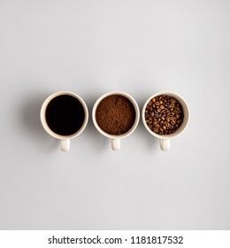 Creative concept photo of three coffee cups on grey background.
