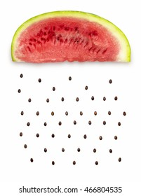 Creative concept photo of a watermelon slice with seeds falling down on white background.