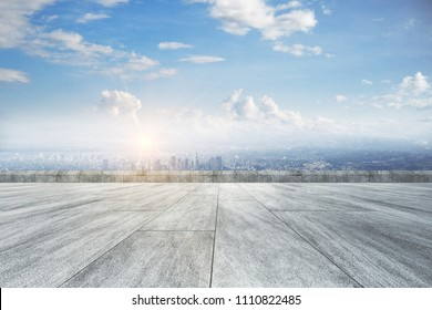 Creative concrete ground, beautiful city view and sky backdrop