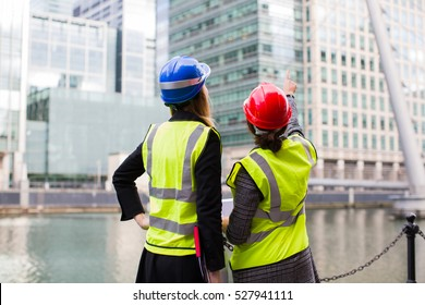 Creative construction workers planing future outdoors