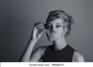 Creative conversion of a woman holding a shard of broken mirror and eyes from another exposure artistic conversion
