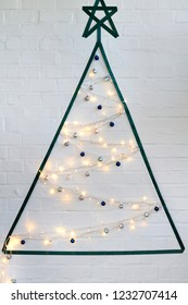 Creative crafty christmas tree using ribbon washi tape, string baubles and fairy lights holiday decorating on a budget