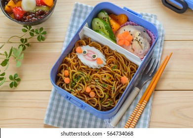 Creative and delicious looking bento box consists of yakisoba noodles, carrot, Japanese cucumber, boiled chicken breast.