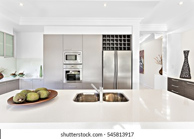 Creative design including furniture, there is a fruit plate close to wash basin, gas cooker is attached to pantry, colorful area.