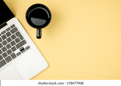 Creative design mockup set of workspace desk with cup of coffee and notebook. Copy space colored background