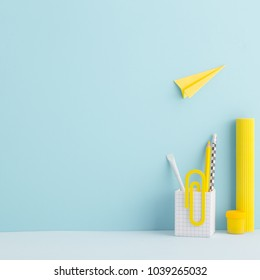 Creative desk mock up with yellow supplies and paper plane. Back to school mock uo.