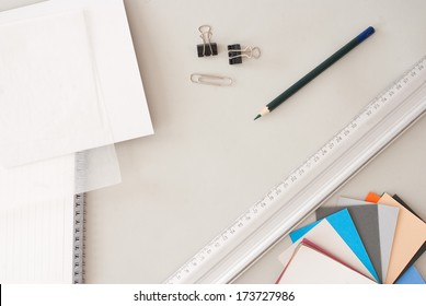 Creative Desktop from Above - pencil, paper sheets and pastel tones - Back to School