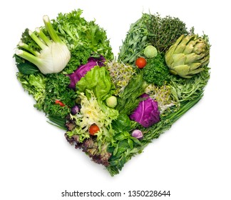 Creative diet food healthy eating concept photo of heart made of fresh greens and vegetables full of vitamins as a symbol of romance love valentine holiday on white background.