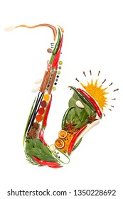 Creative diet food healthy eating concept photo of classical wind instrument saxophone in details made of spices and condiments on white background.