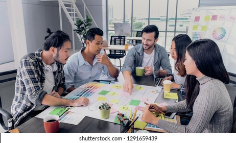 Creative director team lead brainstrom branding project with designer team at meeting table.discussion idea in creative office