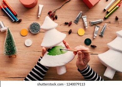 Creative diy craft hobby, woman making Christmas tree decoration from polystyrene for festive holidays