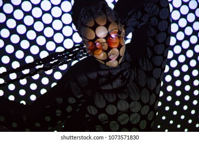 Creative dotted pattern from projection light on beautiful women with dark skin