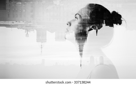 Creative double exposure with attractive girl and modern city, monochrome