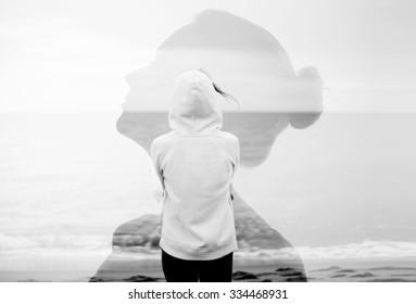 Creative double exposure portrait of attractive girl with sea