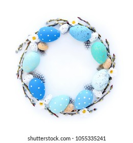 Creative Easter layout made of eggs and willow branches on white background. Circle wreath flat lay concept