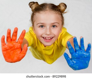 Creative education, little artist - cute girl playing with colors