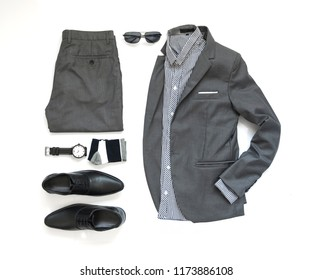 Creative fashion design for men casual clothing set with gray suit , watch, sock, sunglasses, shirt and black shoe isolate on white background, Top view