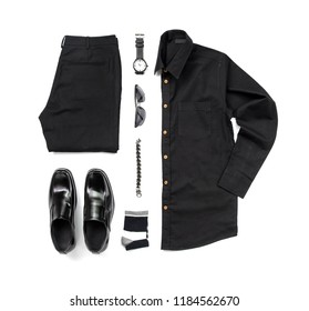 Creative fashion design for men casual clothing set with black shoes , watch, sock, trousers, black shirt and bracelet isolated on white background, Top view