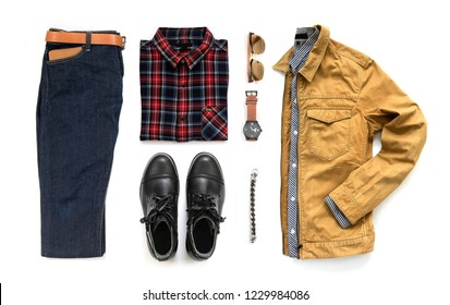 Creative fashion design for men casual clothing set with black boot , watch, blue jeans, belt, wallet, sunglasses, office shirt, yellow jacket and bracelet isolated on a white background, Top view