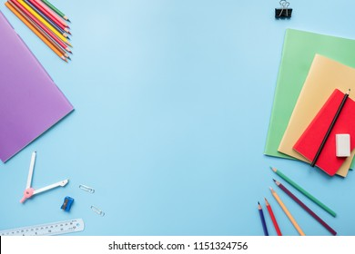 Creative, fashionable, minimalistic, Back to school education concept, school supplies stationery equipment on blue backboard Flat lay with copy space.