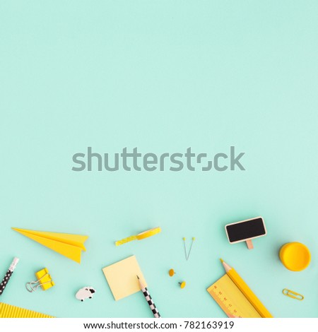 Creative, Fashionable, Minimalistic, School Or Office Workspace With Yellow  Supplies On Cyan Background