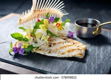Creative fine dining fish dish on slate