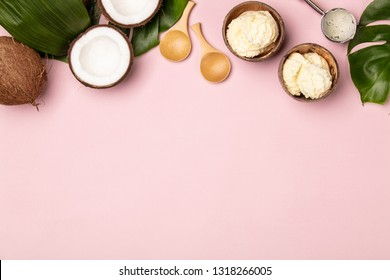 Creative flat lay with coconut ice cream and tropical plants on pink background