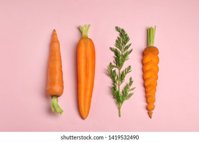 Creative flat lay composition with fresh ripe carrots on color background