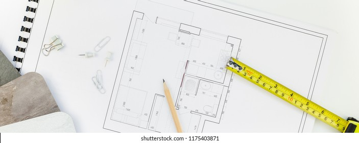 Creative flat lay long wide banner top view blueprints architectural flat project plan and office supplies on decorator white table workspace swatches tools equipment background copy space concept