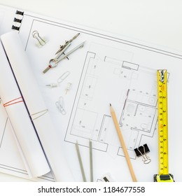 Creative flat lay overhead top view blueprints architectural flat project plan and office supplies on decorator square white table workspace swatches tools and equipment background copy space concept