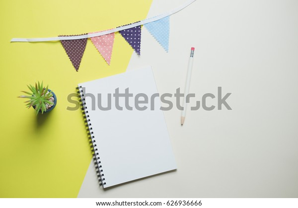 Creative flat lay photo of cute workspace desk with notebook ,decorated cute craft with copy space background, minimal style